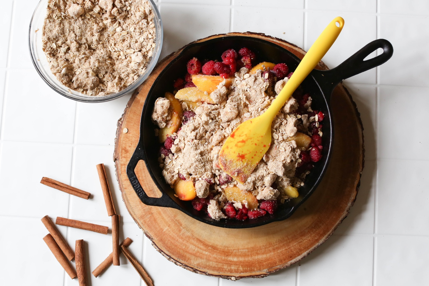 add the crisp topping to the raspberry and peach crisp