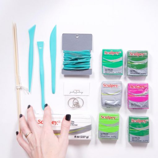 flatlay of cactus clay ring holder supplies