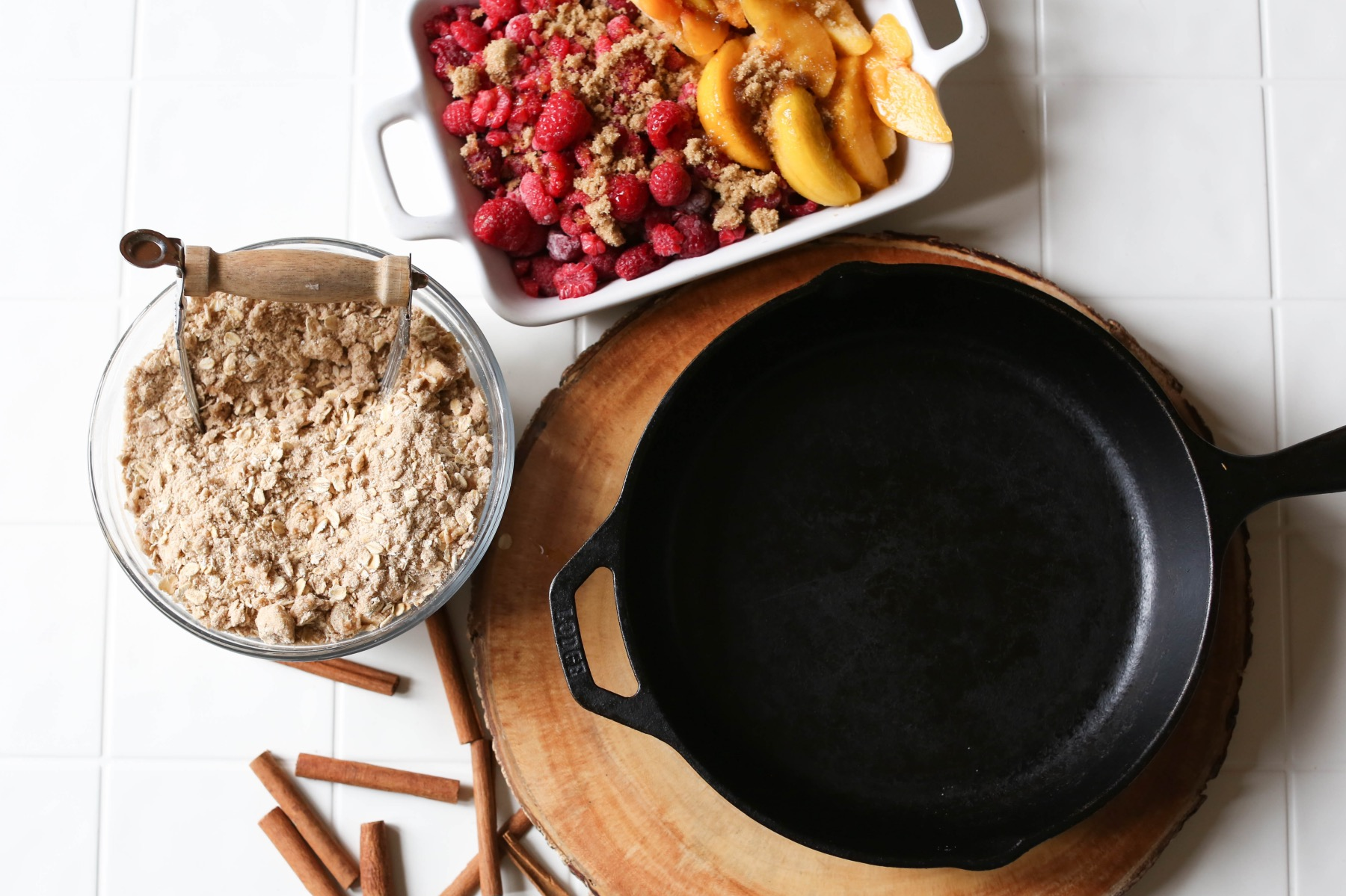 layering the fruit into the cast iron skillet crumble dessert recipe