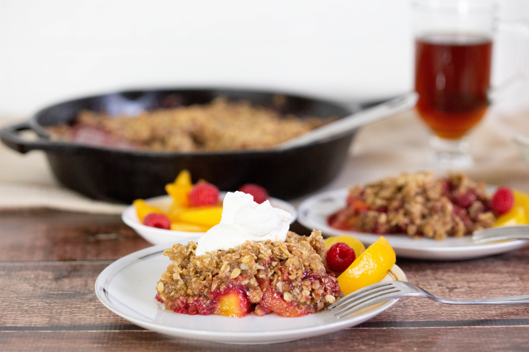 serving a raspberry and peach crisp dessert