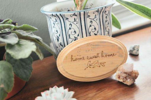 wood burned oval plaque