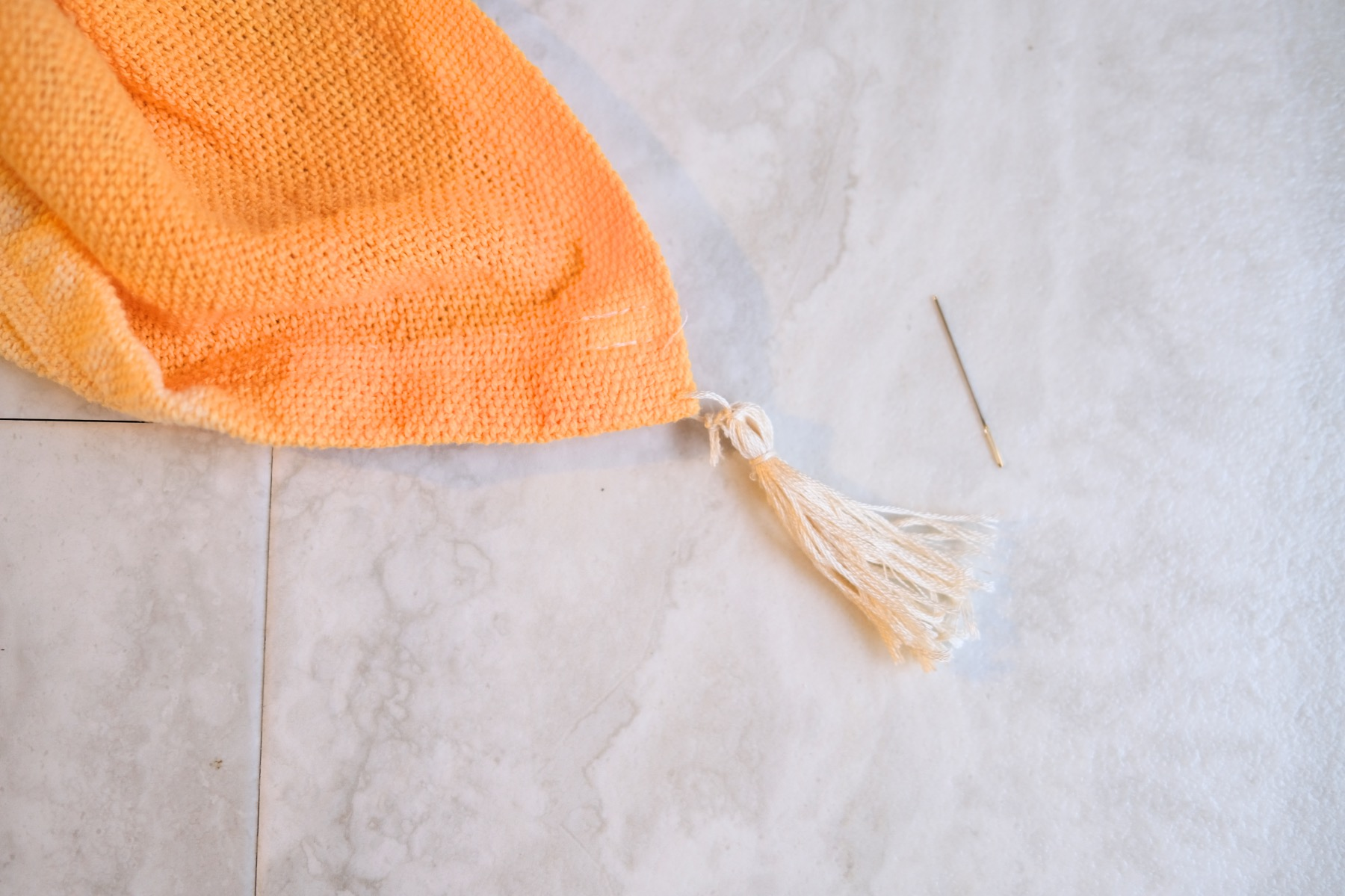 finished tassel on the edge of the blanket