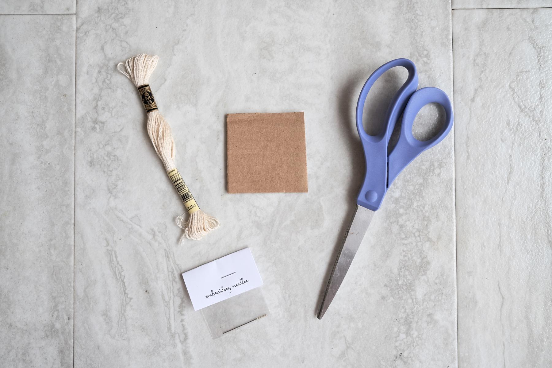 supplies to make a diy tassel blanket craft tutorial