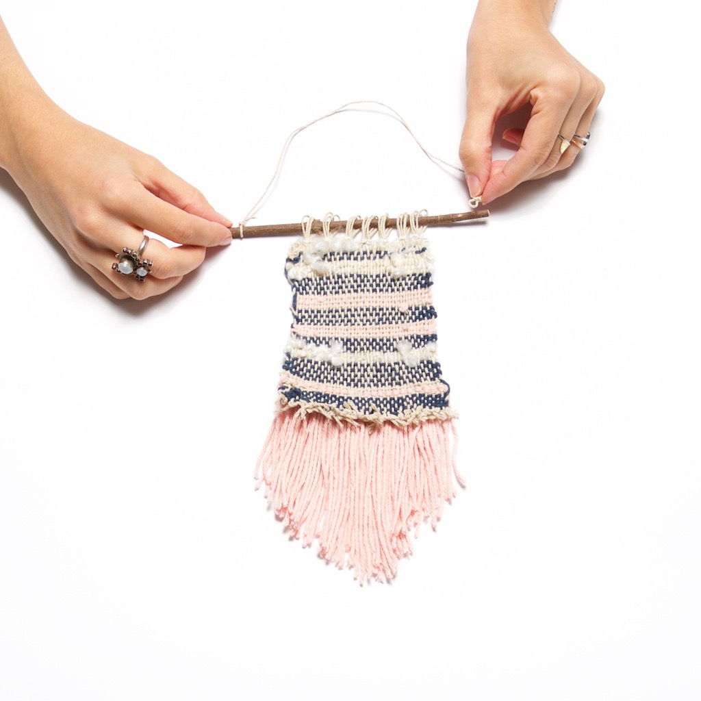 add the hanger to the woven wall hanging