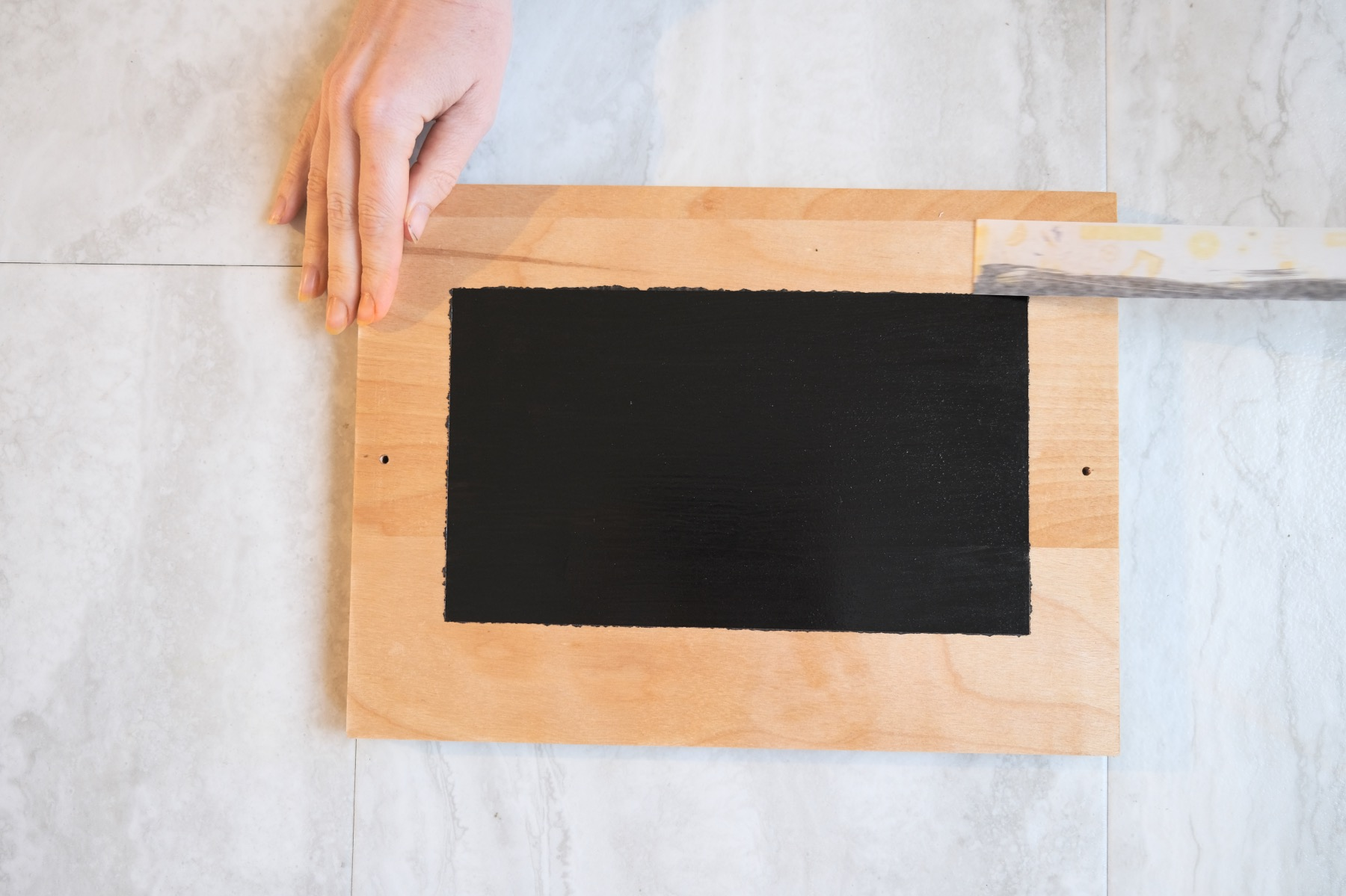 craft tutorial for chalkboard paint tray with tape removed