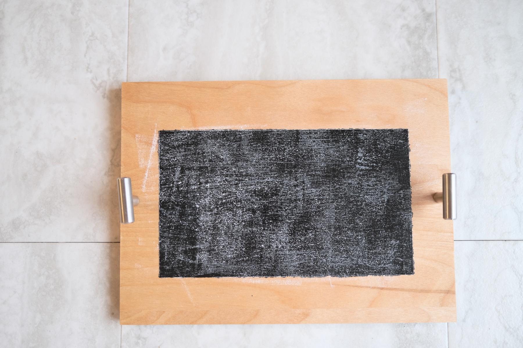 dry chalk coating a chalkboard to season it