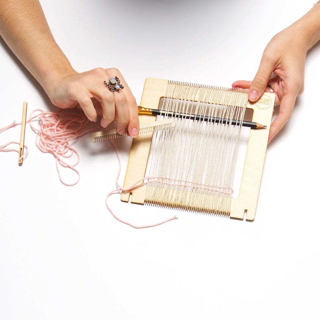 how to comb the yarn into place in a loom weaving project