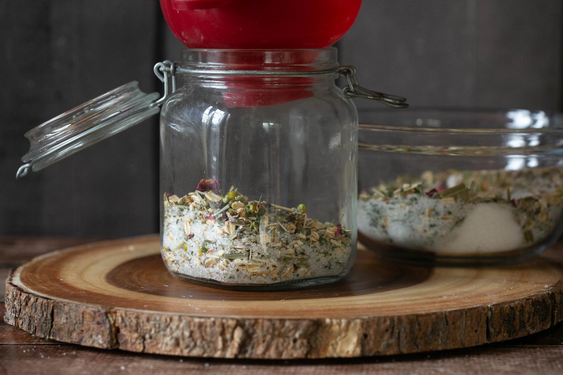 pour forest bath soaks ingredients into a glass jar