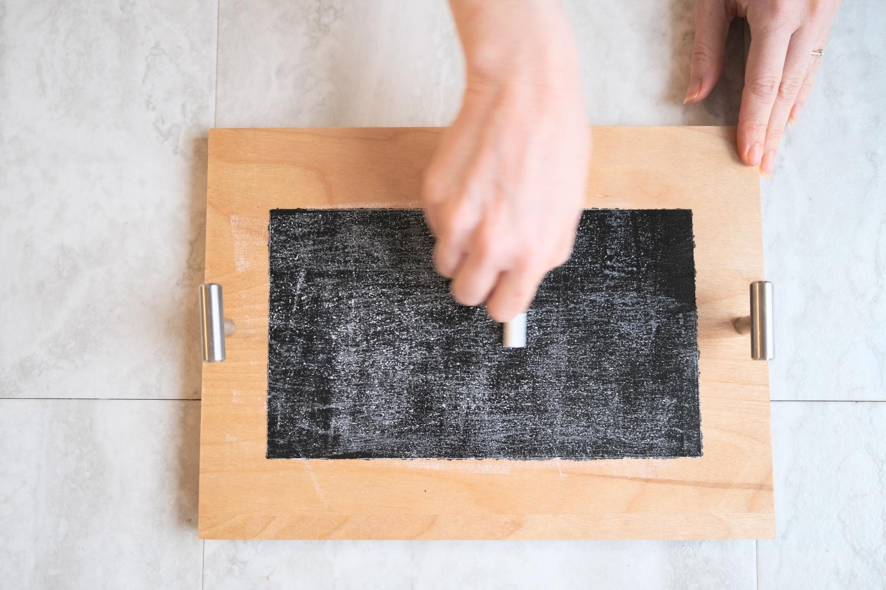 rub the chalk across the entire chalkboard to season it