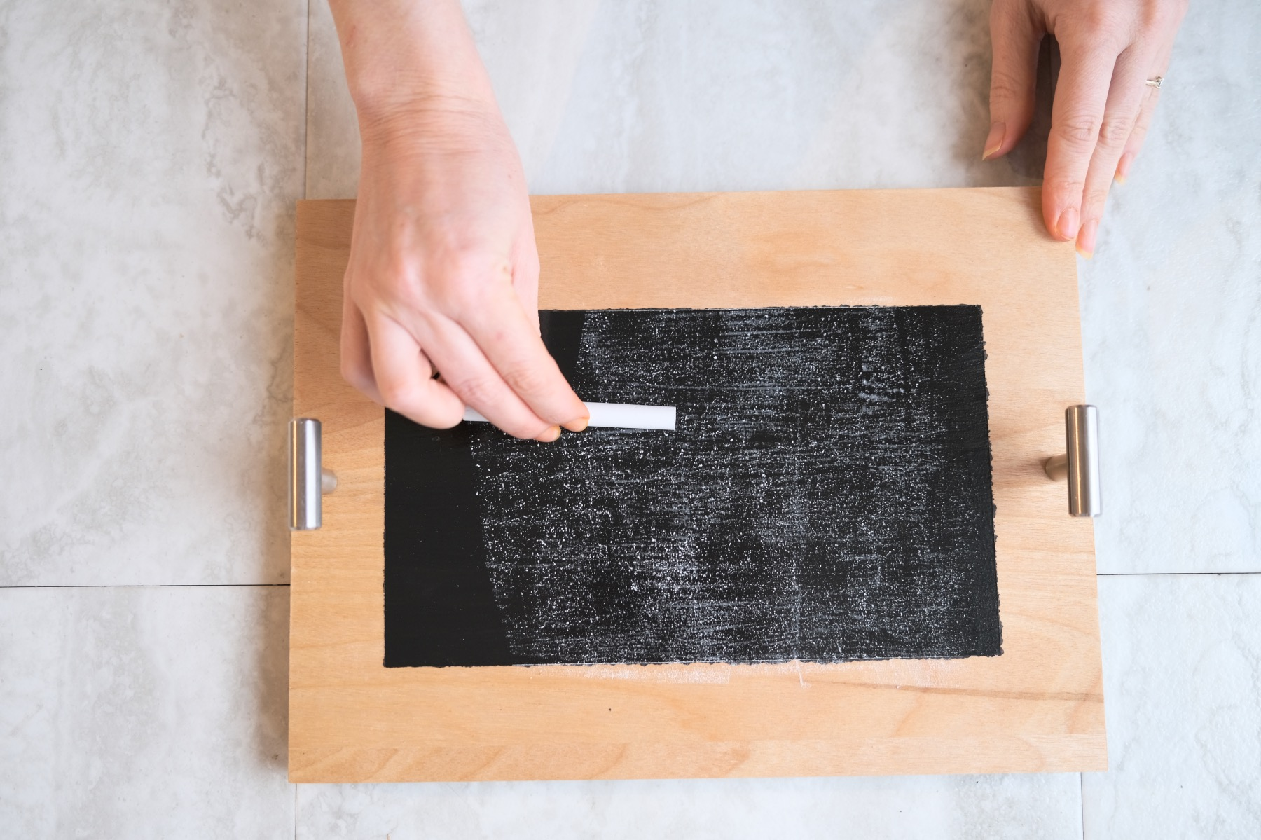 rubbing a chalkboard with dry chalk to season