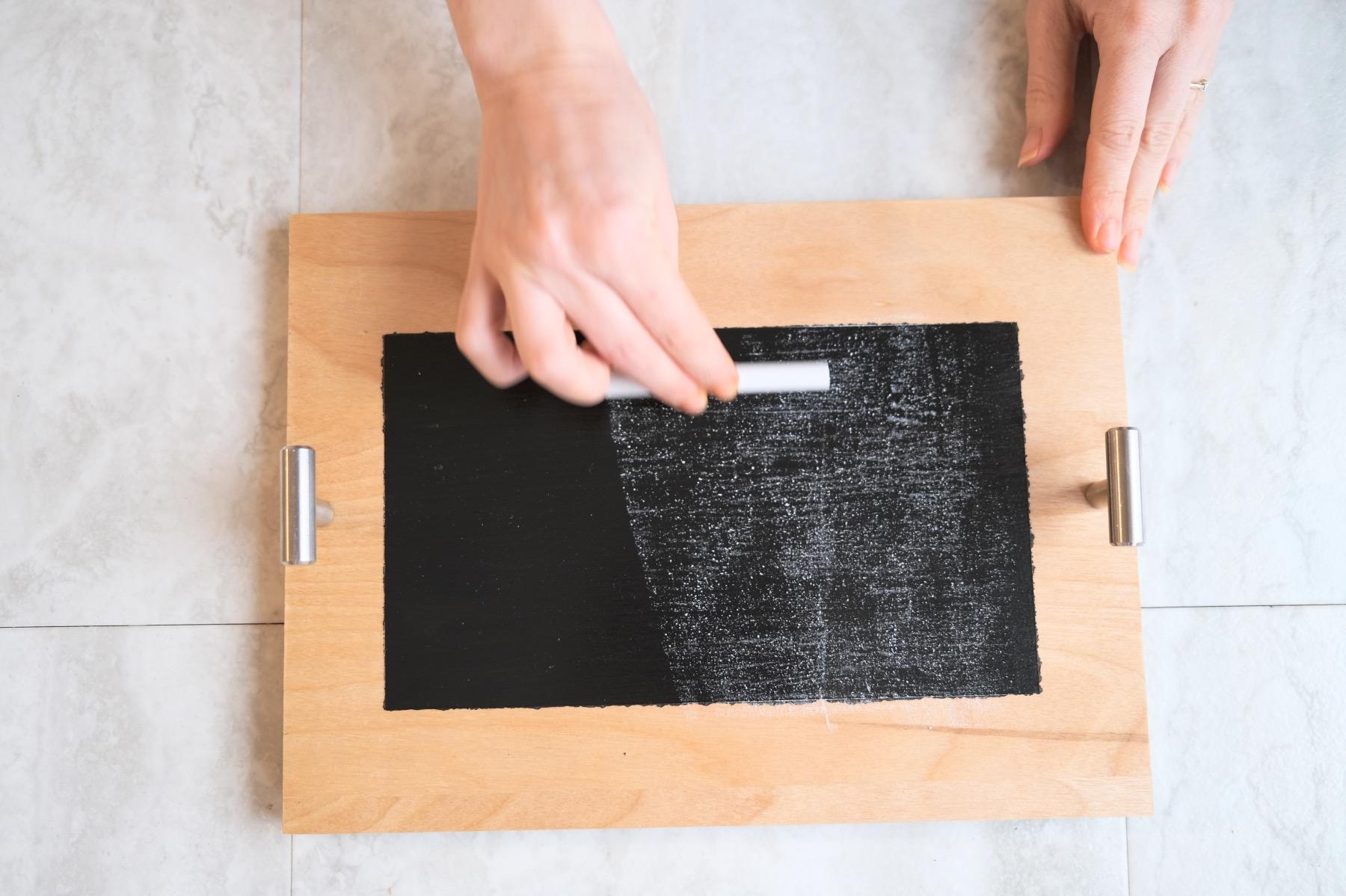swipe the chalkboard with chalk to season a chalkboard