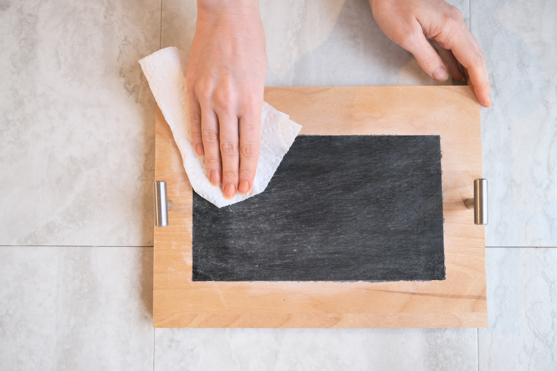 wipe off the dry chalk to make a chalkboard tray