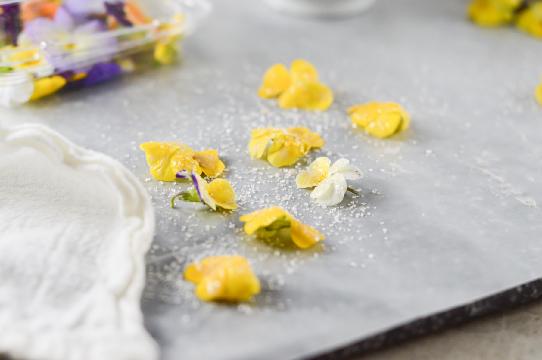 drying candied flowers on parchment