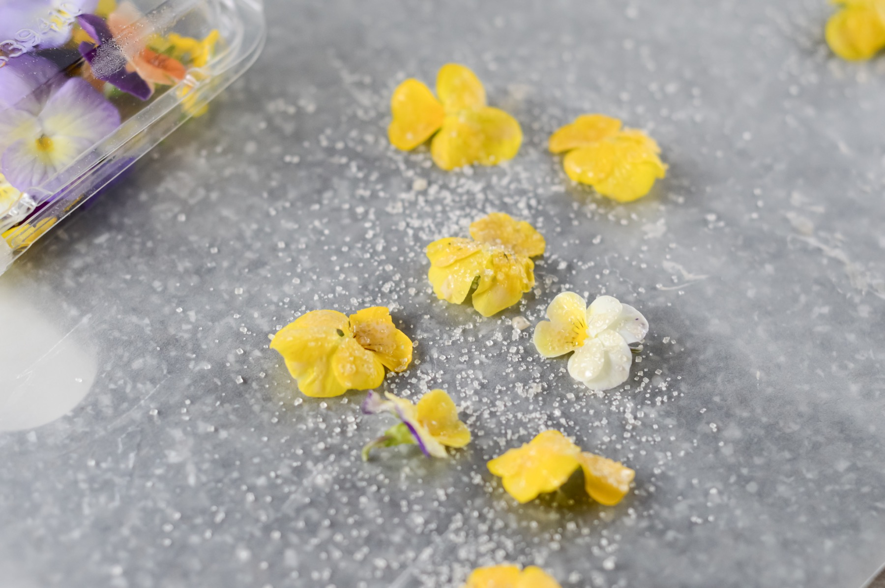 lay the flowers on parchment to make candied flowers