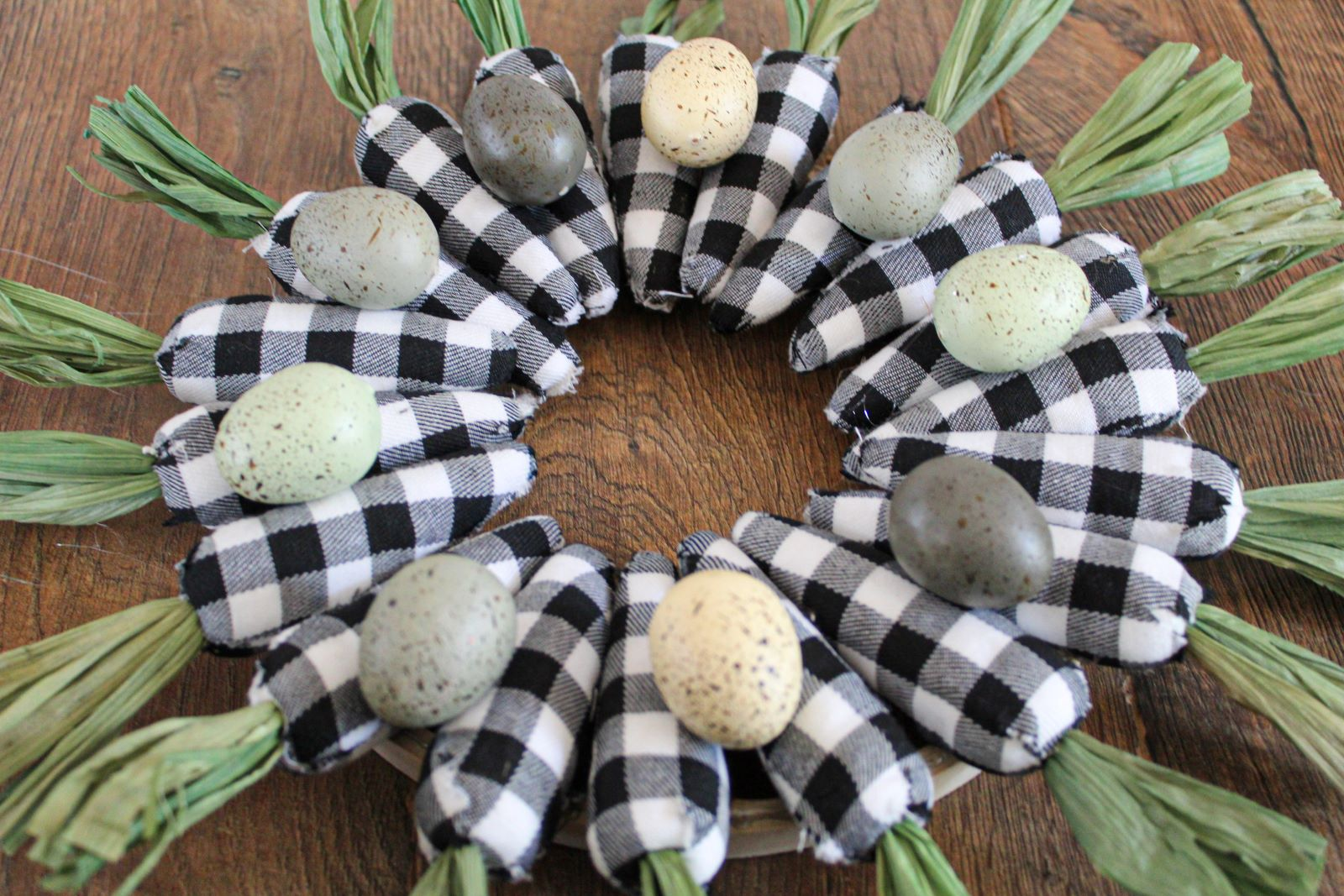 Flat view of black and white plaid easter carrot wreath 1