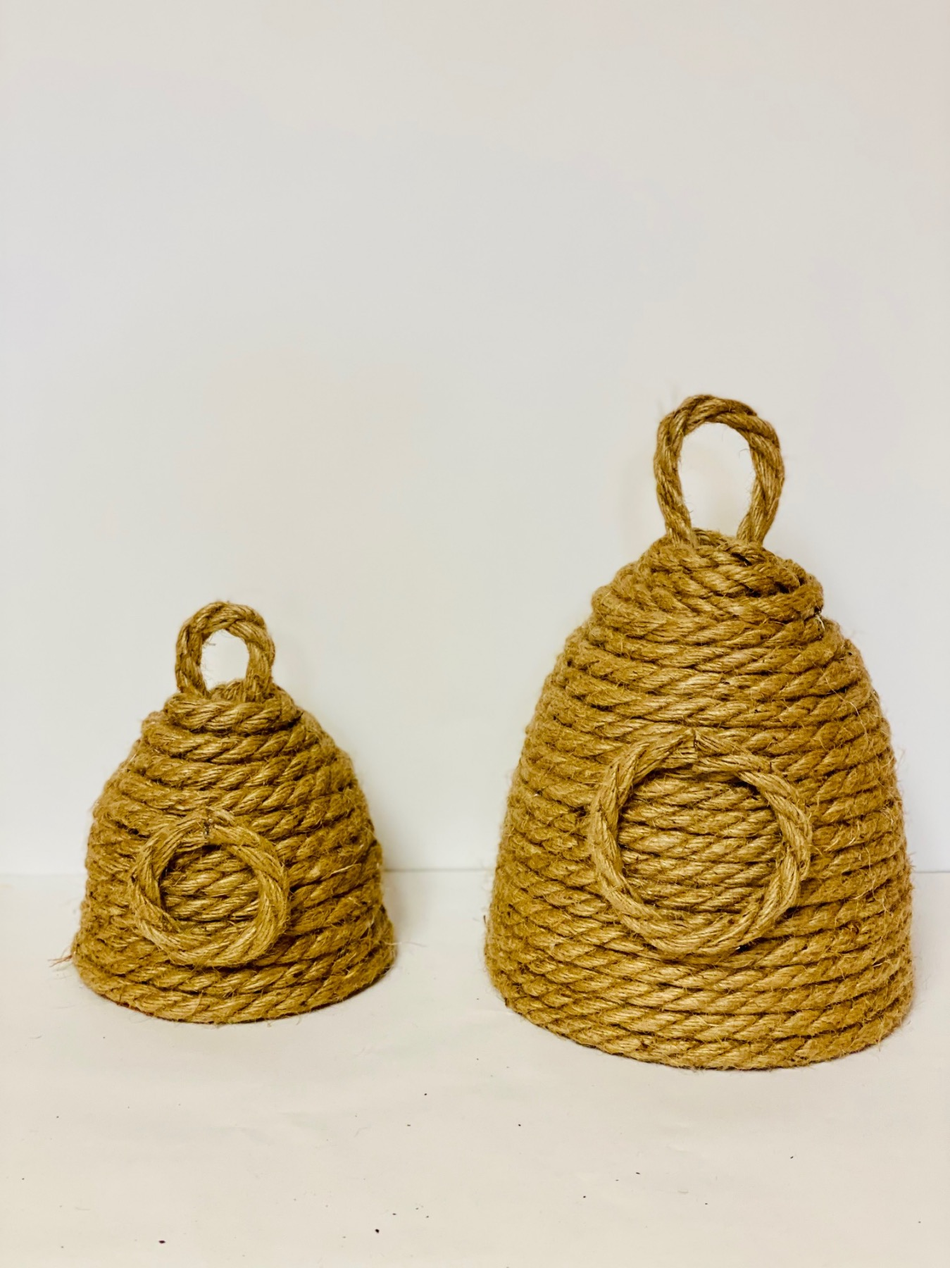 2 finished rope beehives ready to paint