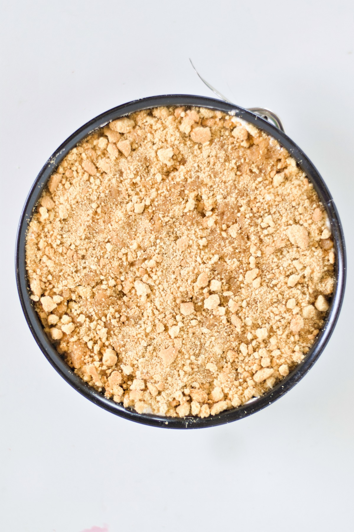 add the crumble topping to the strawberry cream crumble