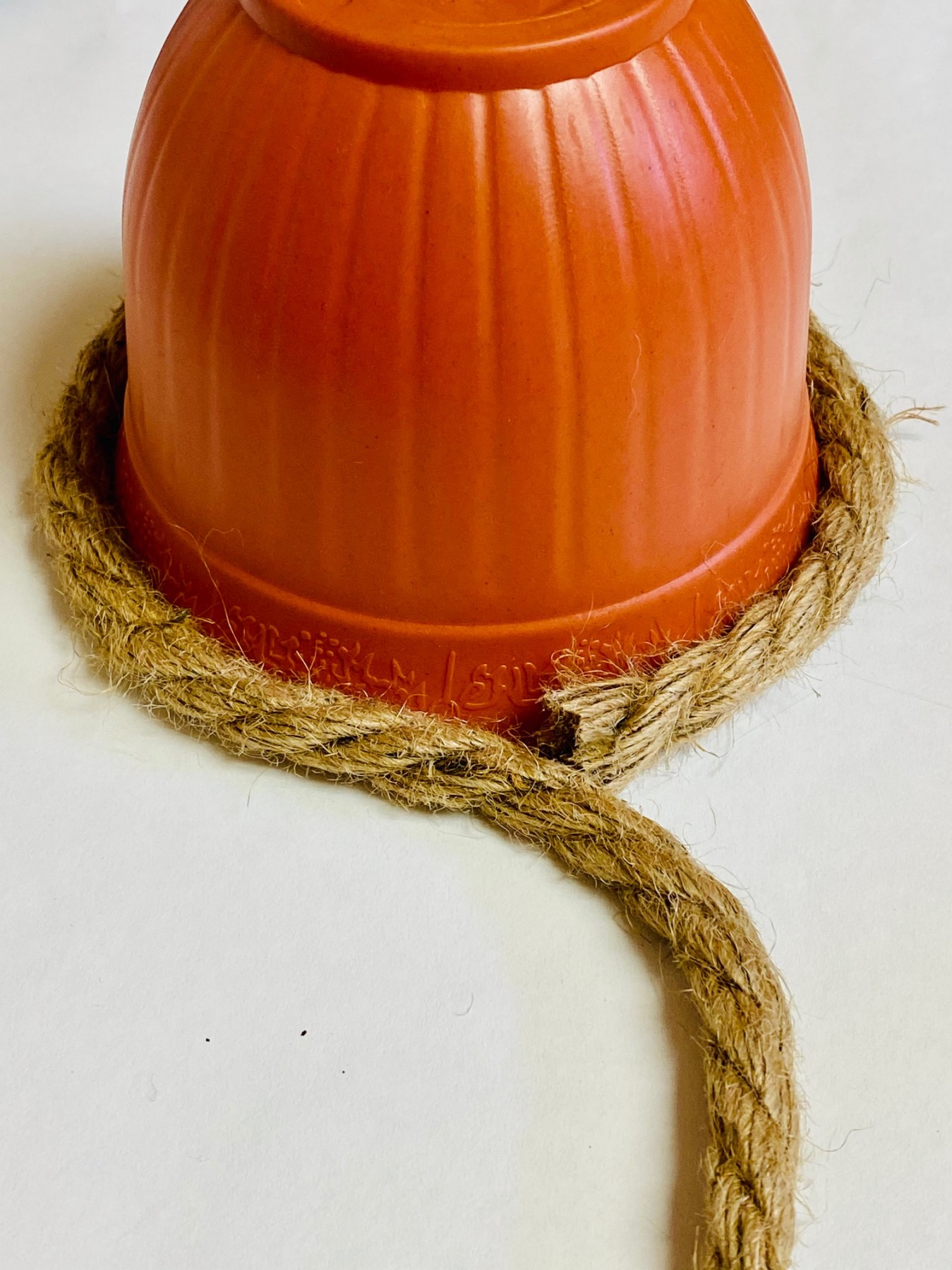 attach the rope at the base to make a beehive decoration