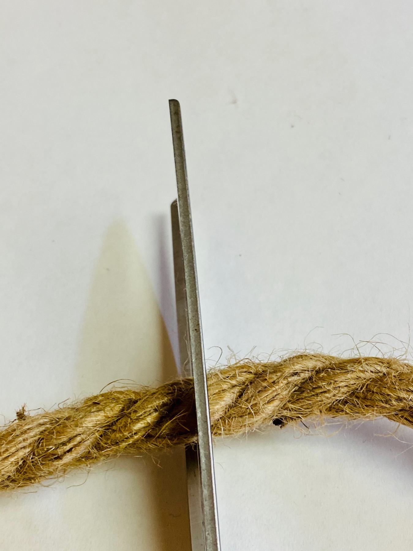 cut a section of rope to make the top of the beehive