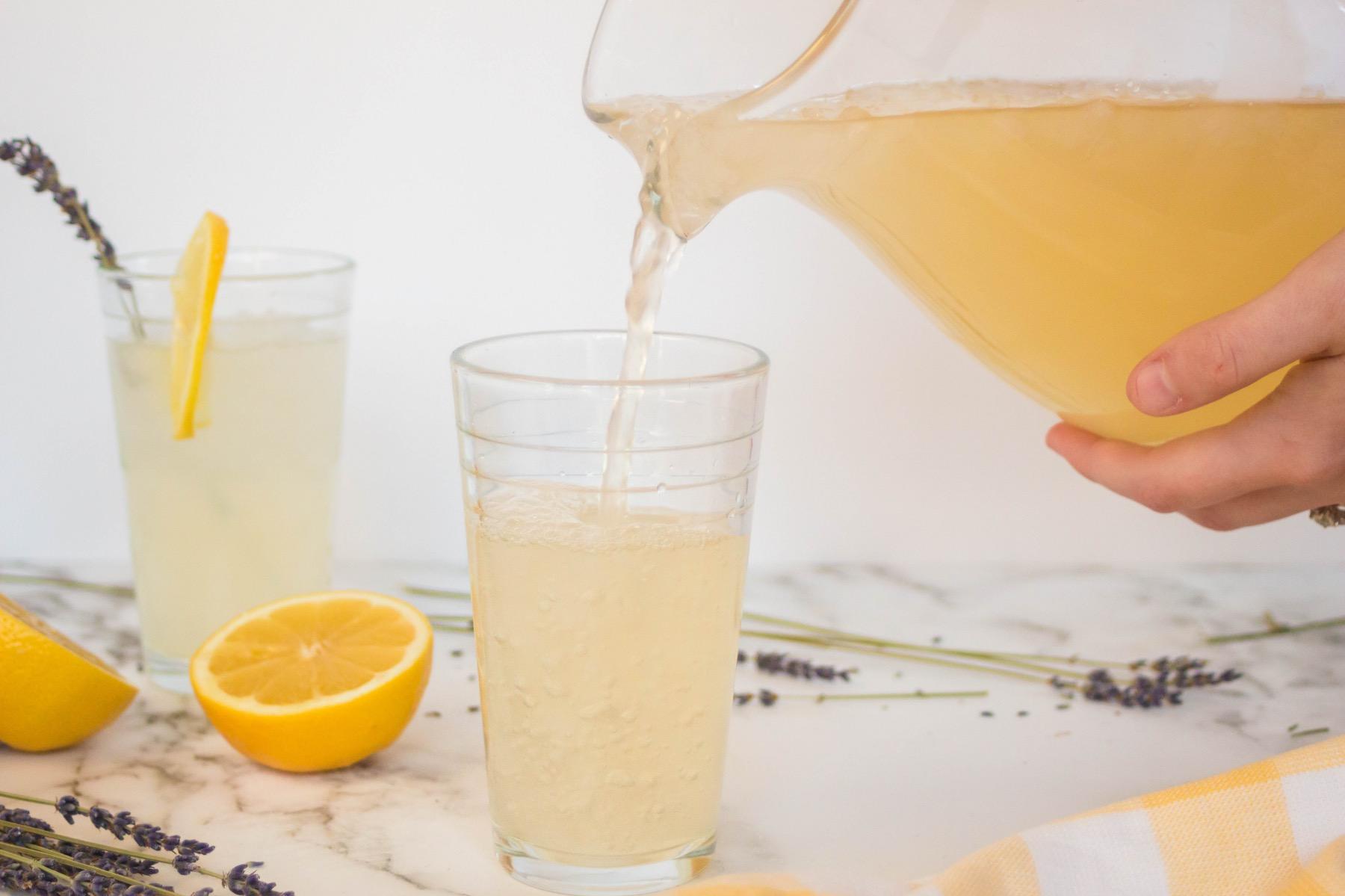 serve homemade lavender lemonade in a tall glass