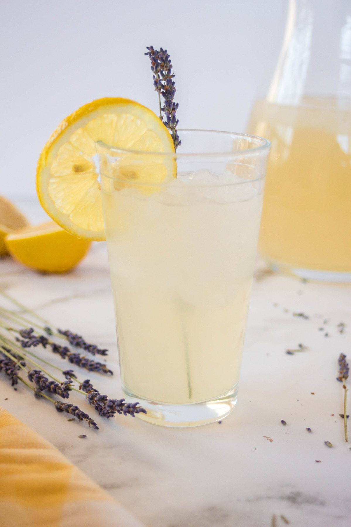 serve lavender lemonade over ice with a sprig of herbs