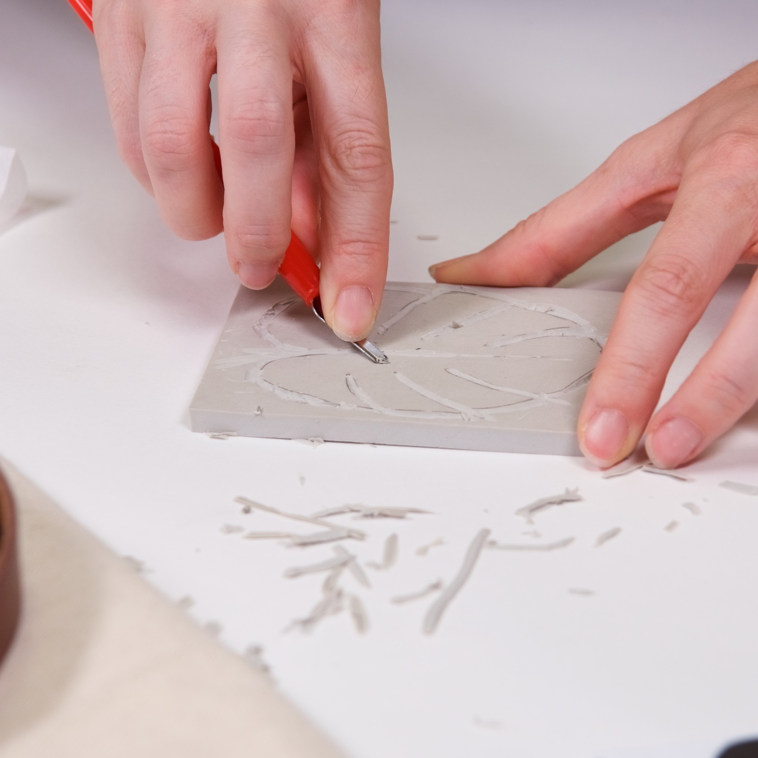 carve the interior of the block printing surface