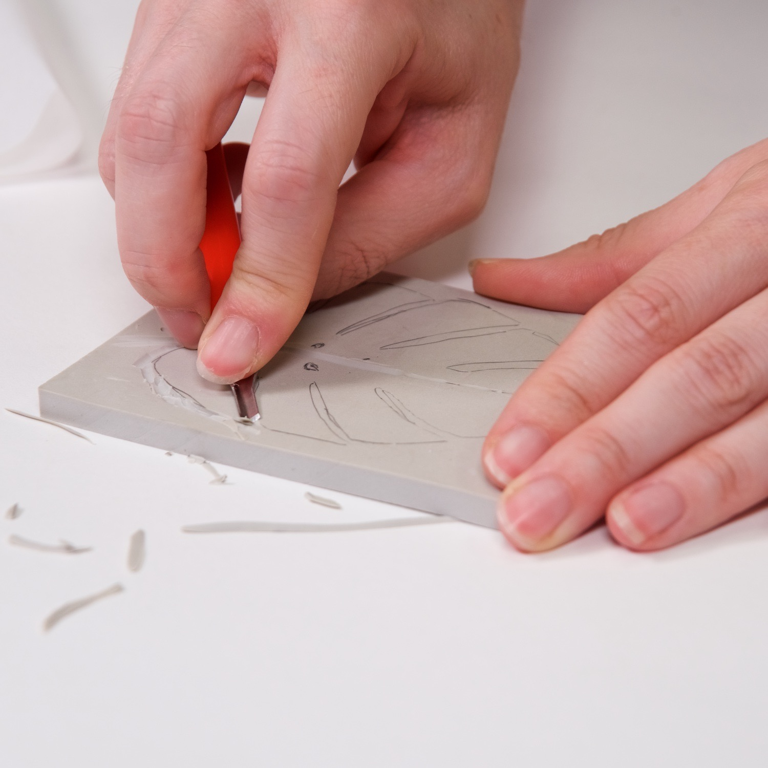 carve the linocut block to leave tall surface