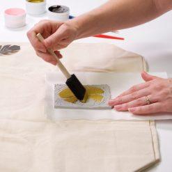 coat the linocut block with fabric paint craft tutorial