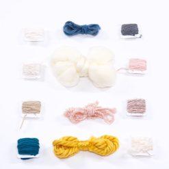 flatlay of yarn and twine in full kit diy weaving loom craft supply