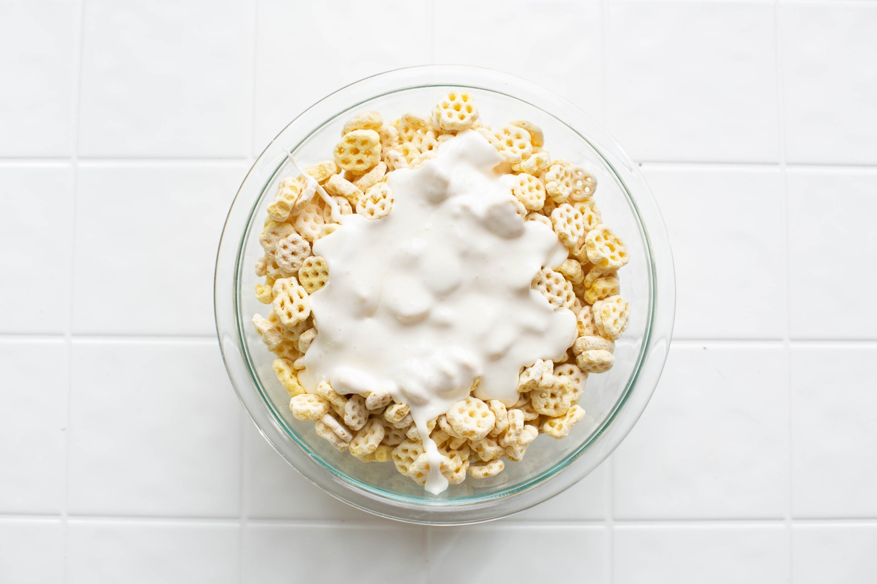 mix together the marshmallows and honeycomb cereal