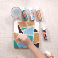 painting inside the painters tape to make a chevron square