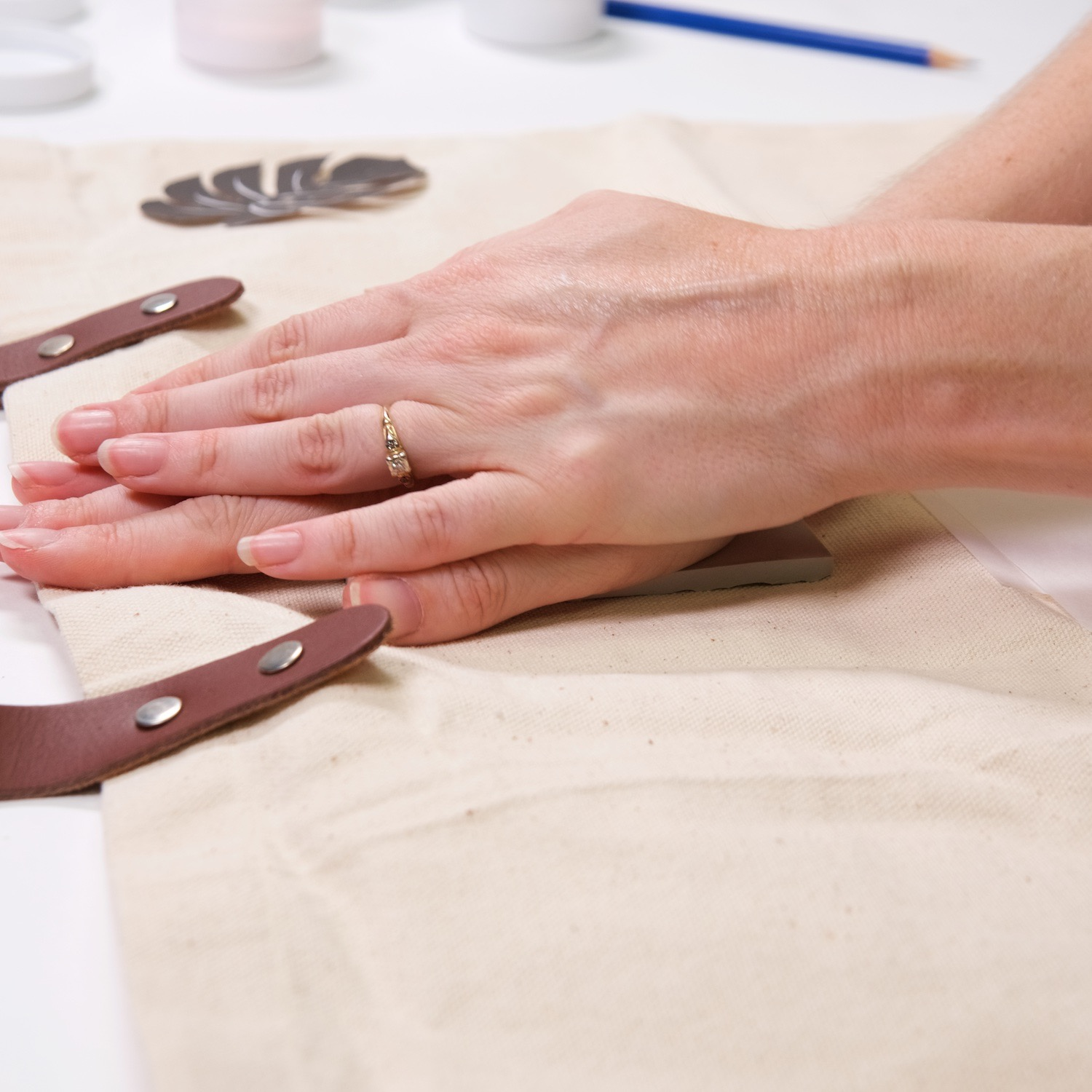 press the linocut block into the fabric to make a print