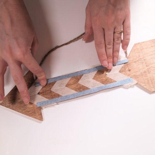 taped chevron on a wood arrow diy tutorial square