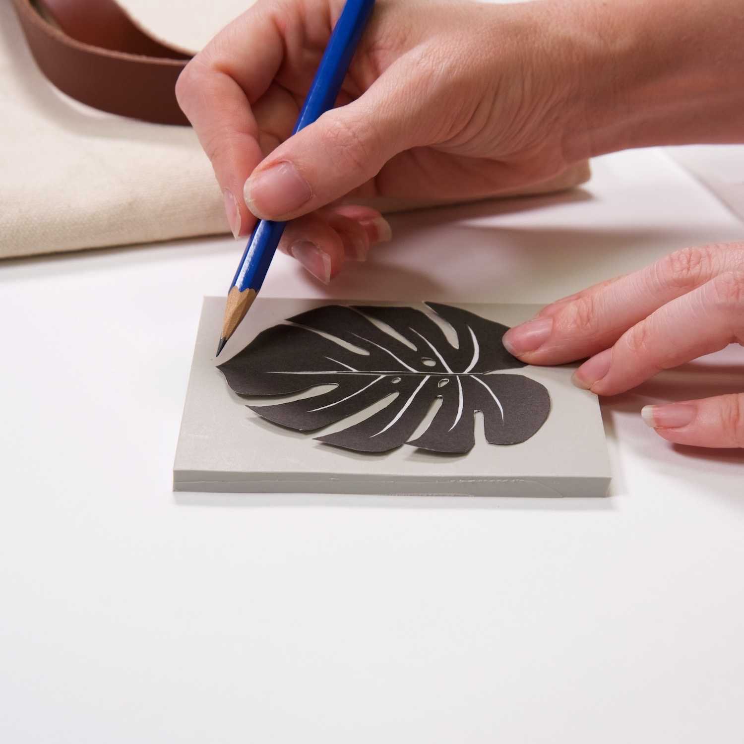 trace the outside of the template to make a linocut
