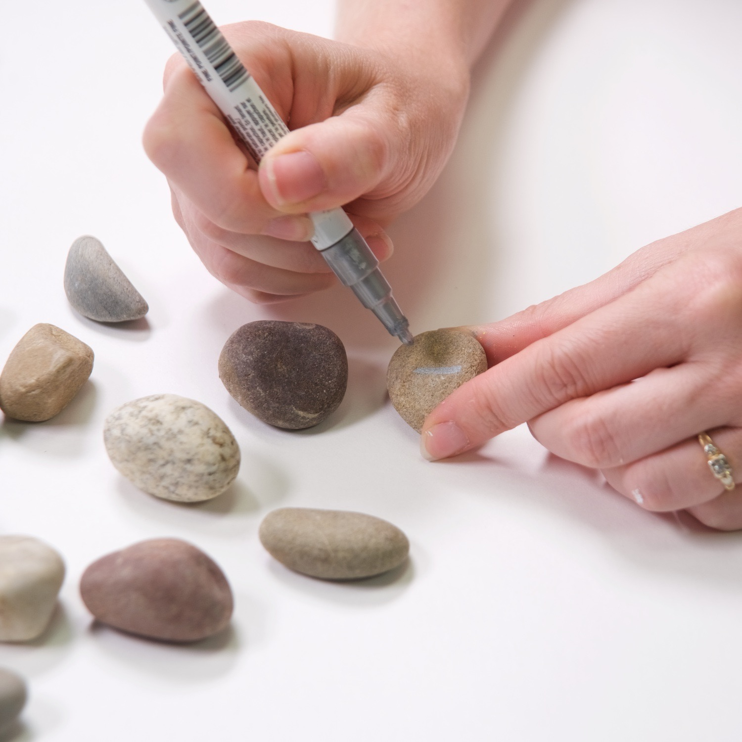draw a line on the rock to start making dominoes