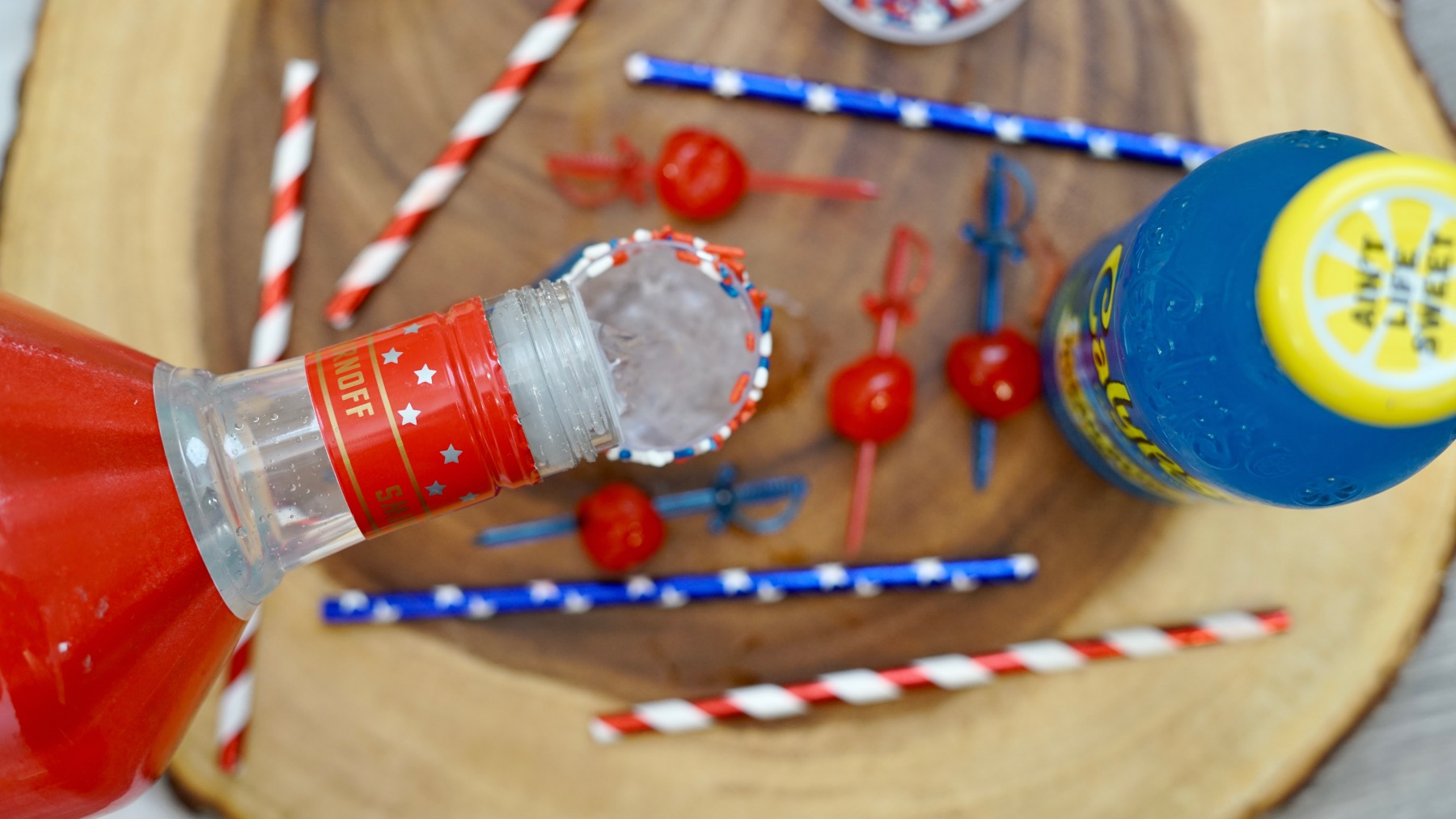 pour in the smirnoff red, white, and berry pop shop america