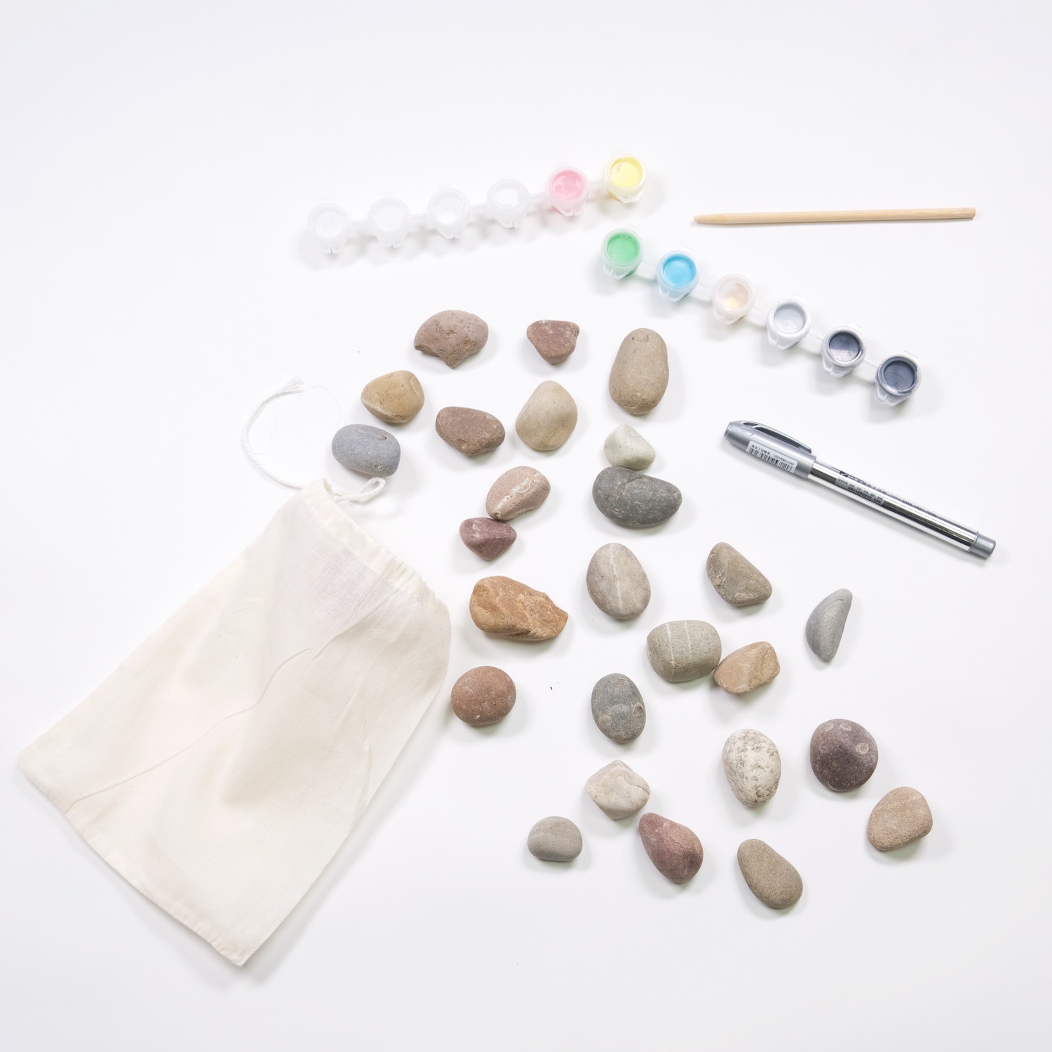 supplies to make a rock domino set with acrylic paint
