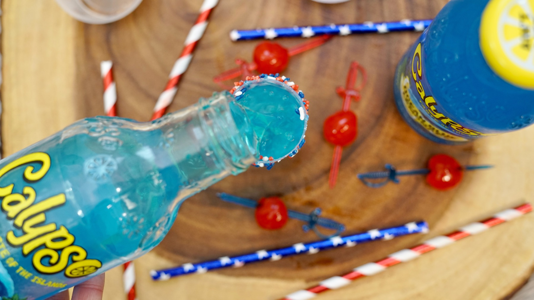 top the cocktail shot with calypso ocean blue lemonade