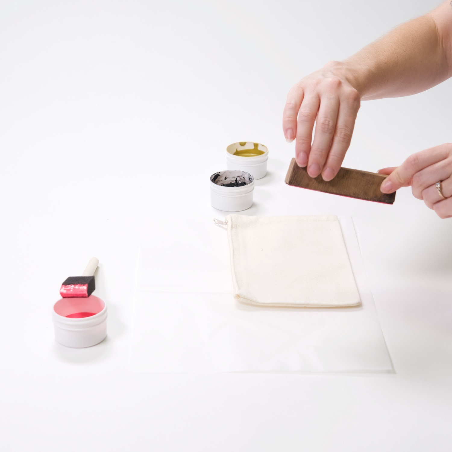 press the wood block into the zipper pouch