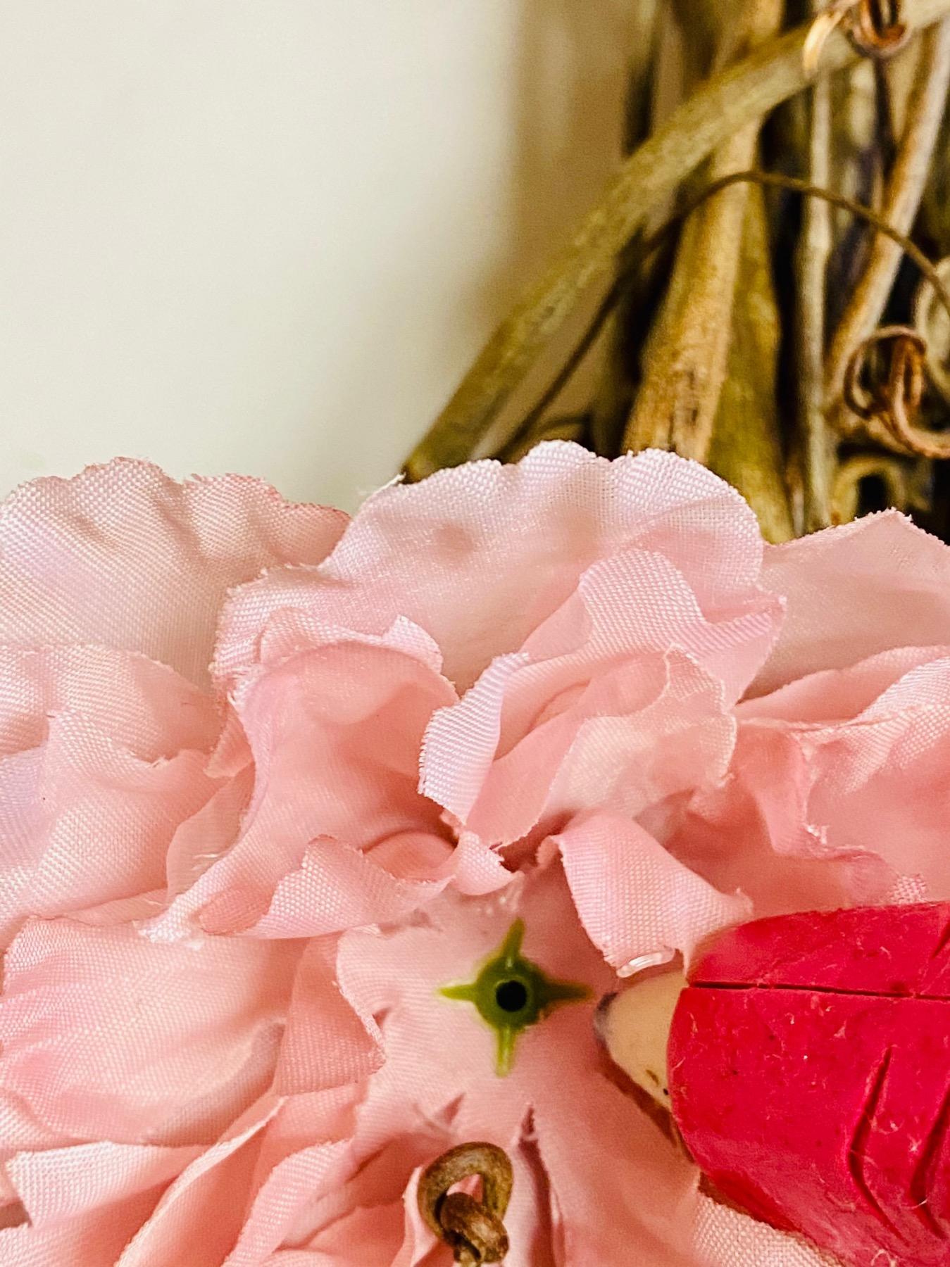 use a hot glue gun to attach the faux flowers