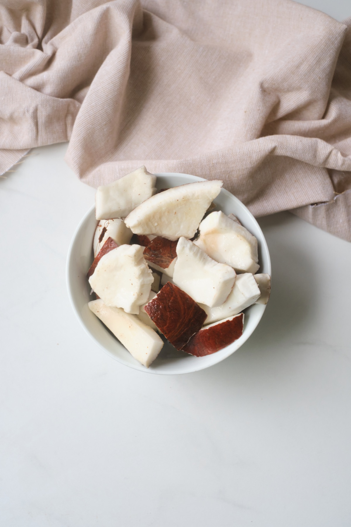 coconut pieces before the peel is removed