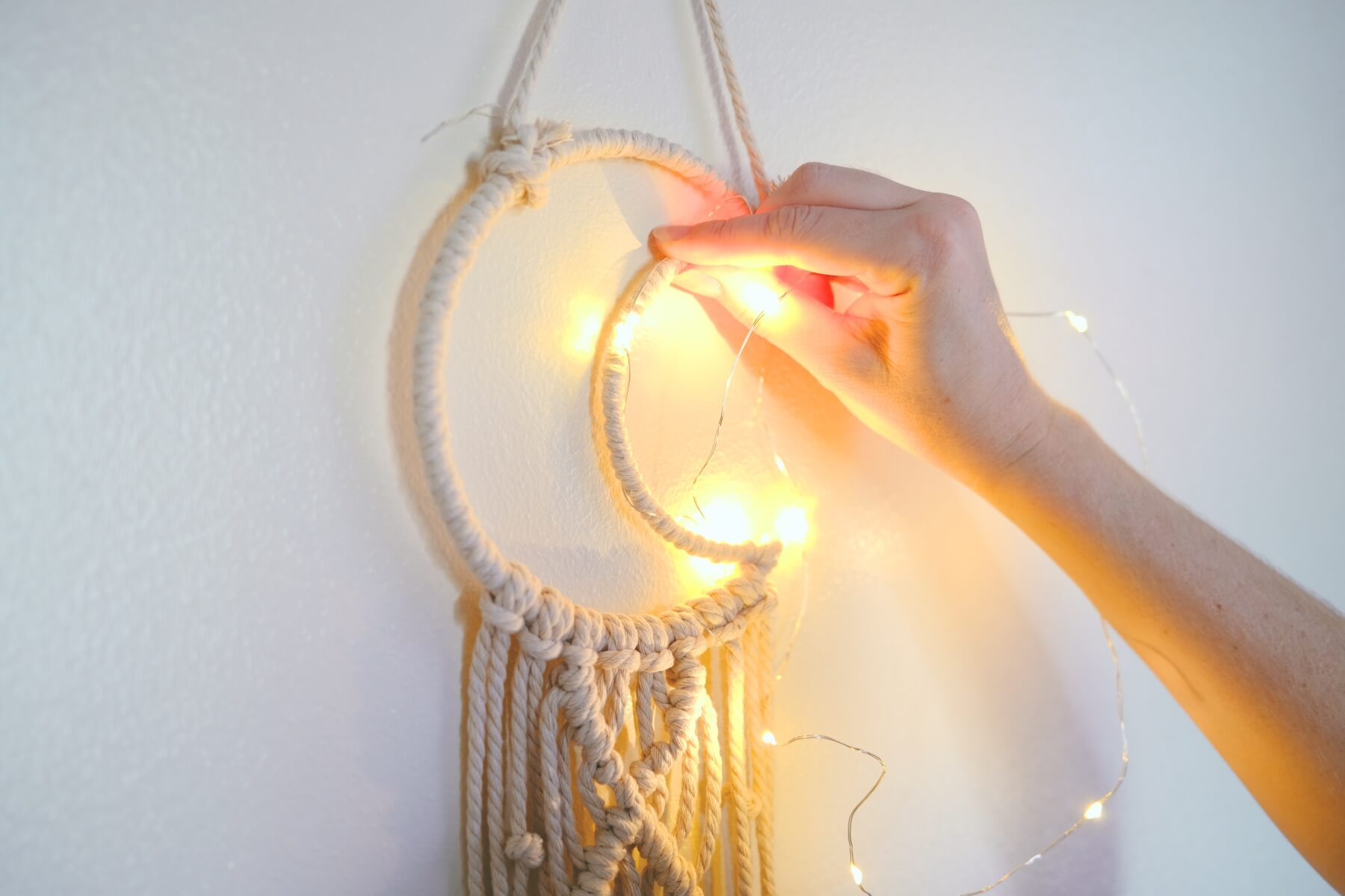 add the string lights to the moon wall hanging