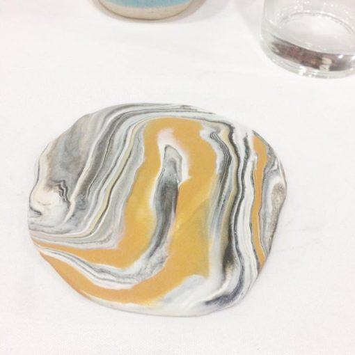 close up of diy marbled clay trinket dish