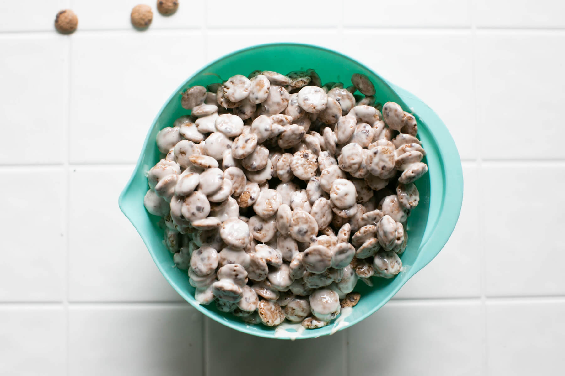 evenly coat the cookie crisp cereal with marshmallows