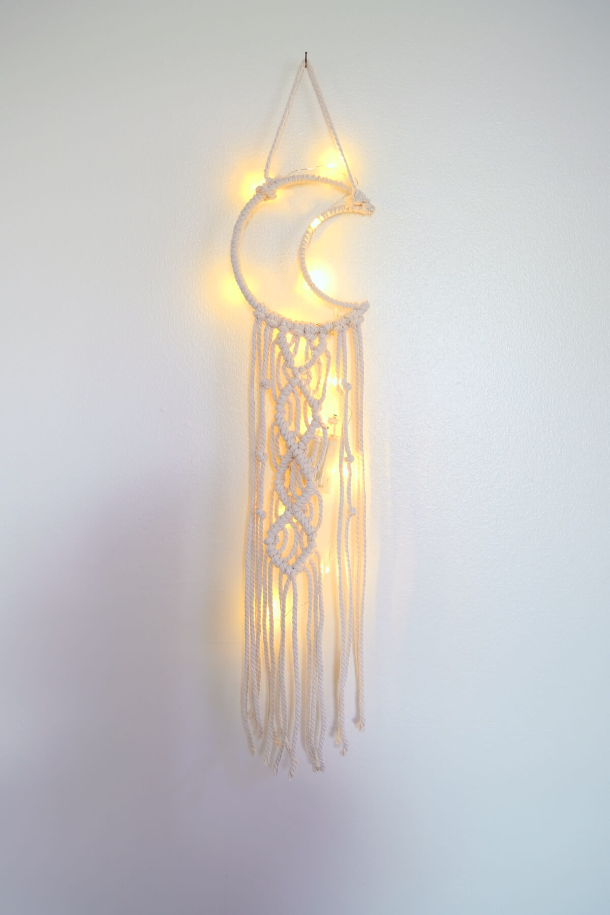 finished macrame moon wall hanging tutorial