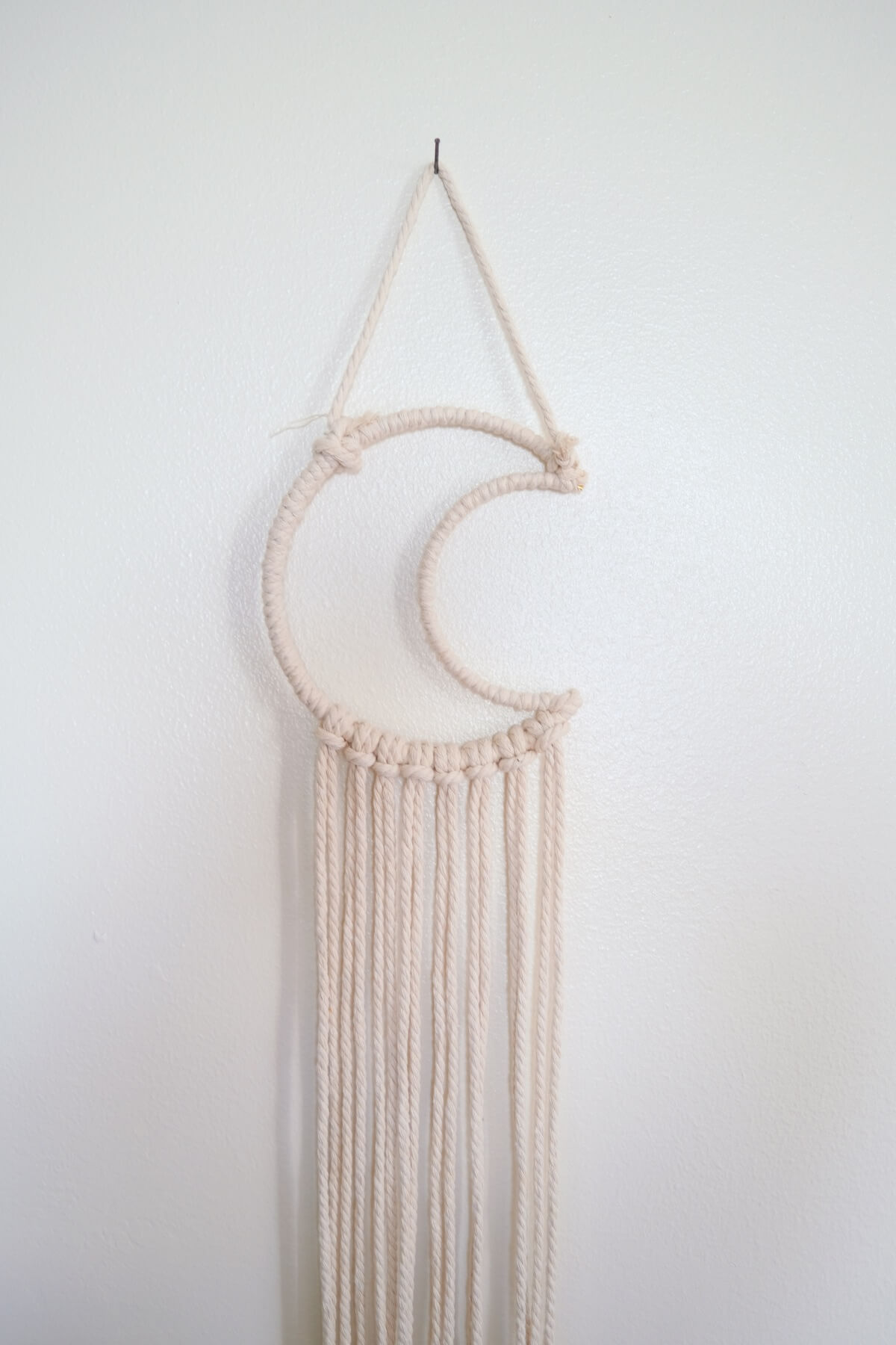 hang your macrame wall hanging on the wall