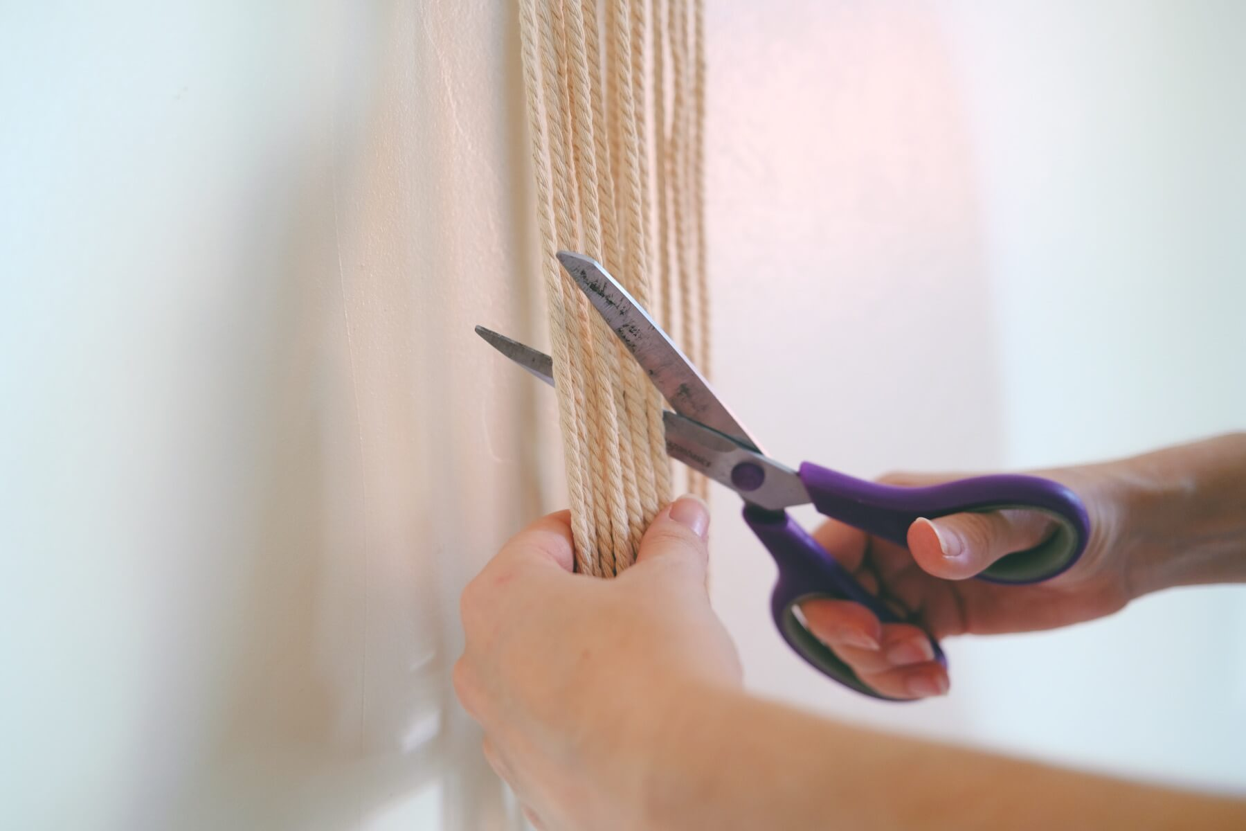 trim the ends of the macrame wall hanging